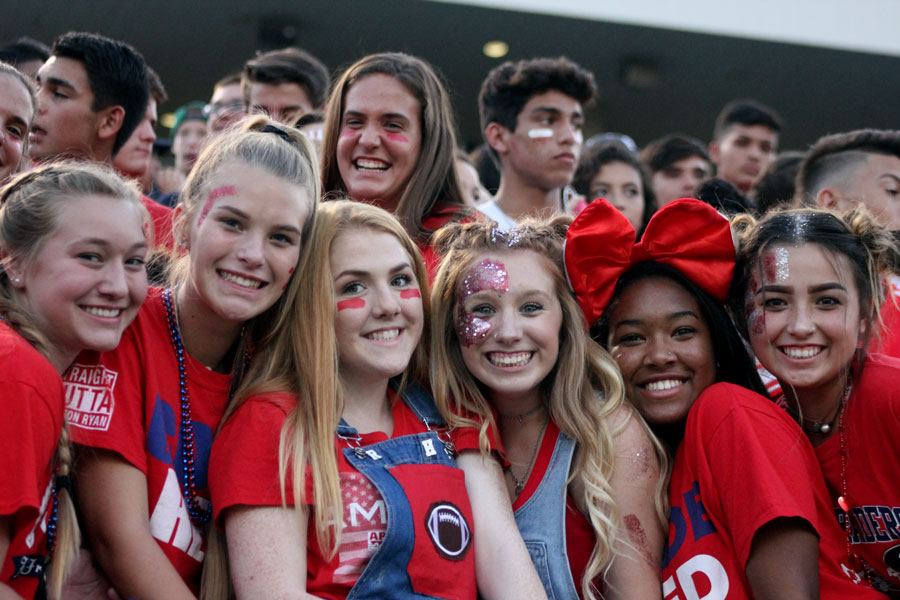 Savannah Baldwin, third from the right, shows her school spirit during the first football game of the season.