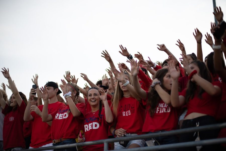 The+Ryan+High+School+student+section%2C+Code+Red%2C+cheers+on+the+varsity+football+team+during+kickoff+of+the+game+against+Mesquite+Poteet+High+School.+